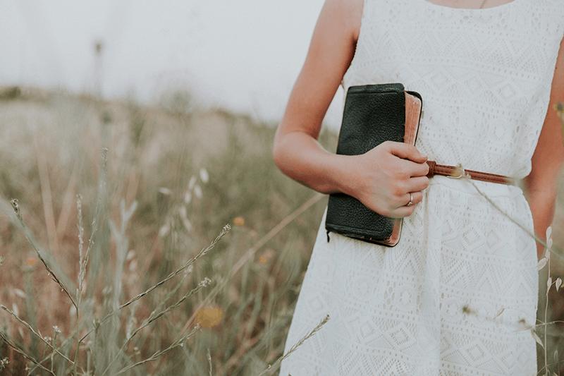 Woman clutching the Bible