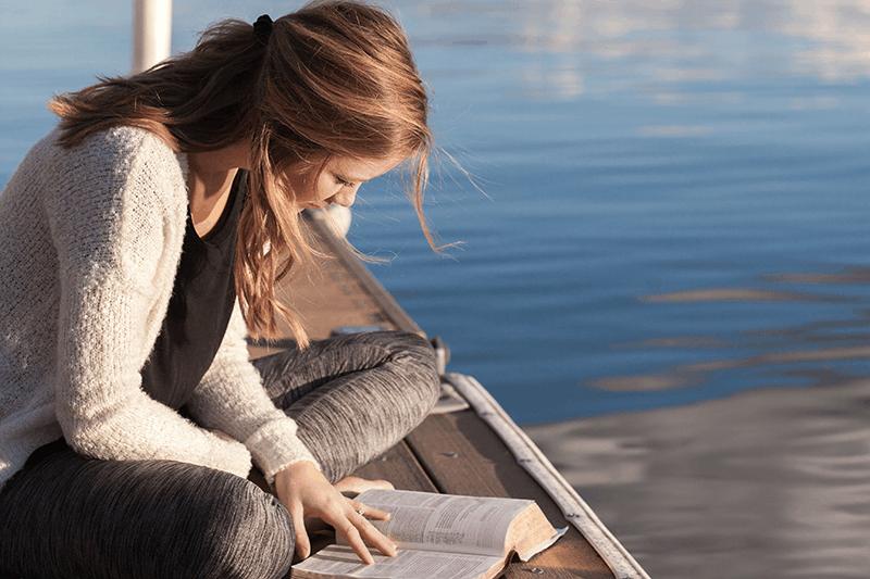 Woman enjoying Bible Study sitting on dock