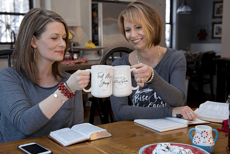 Christian Women enjoying Bible Study and coffee in their Living by Design Support Team mugs