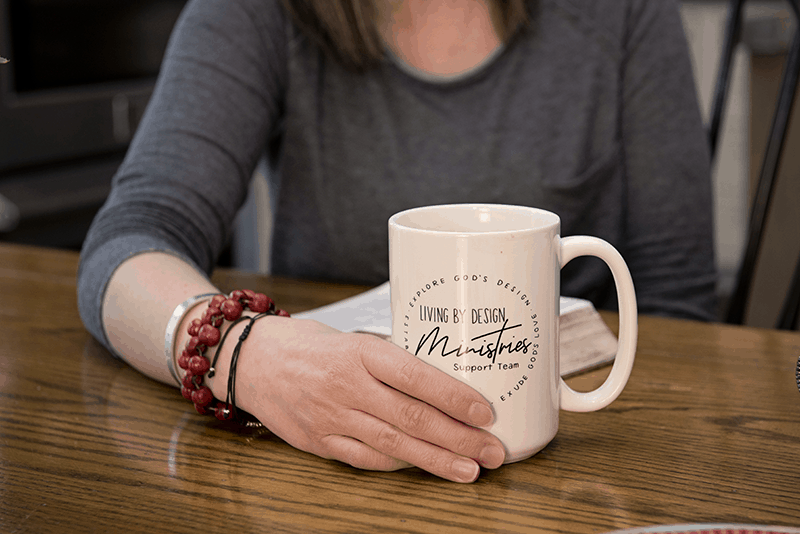Photo of the Living by Design Support Team Mug with the Ministry Logo and Mission Statement