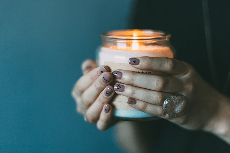 brokenhearted christian woman holding a candle of hope