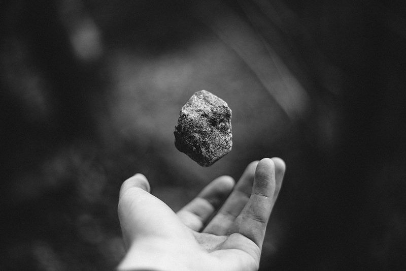 a hand ready to throw a rock