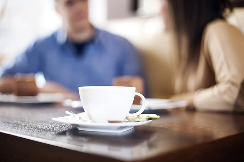 father and daughter drinking coffee discussing living by design ministries