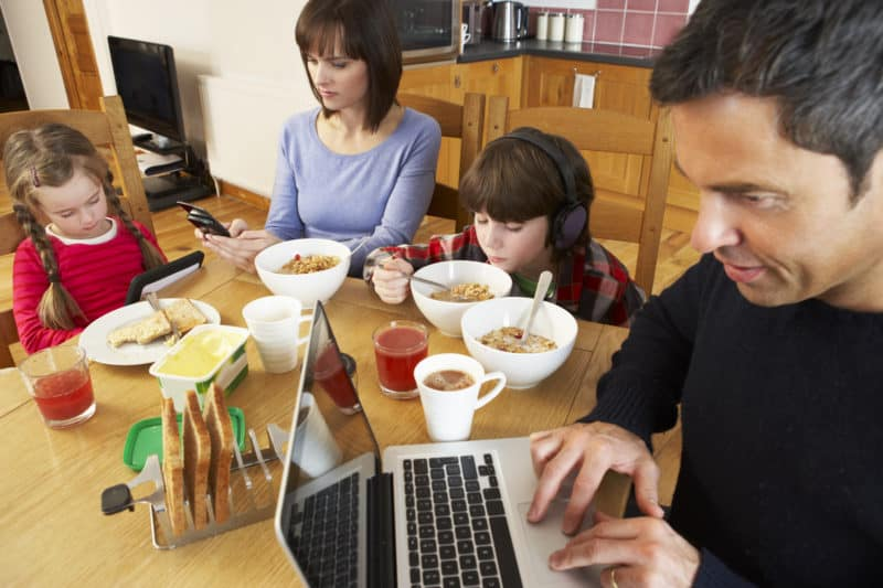 family on devices around breakfast table needing to change their family culture