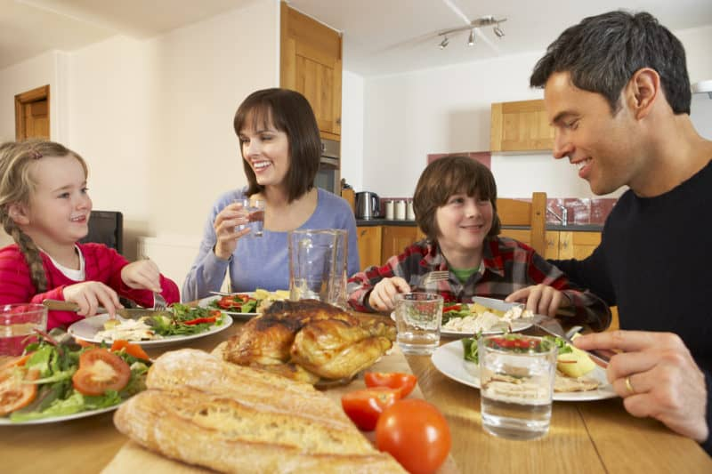 family around supper table enjoying each other with a positive family culture