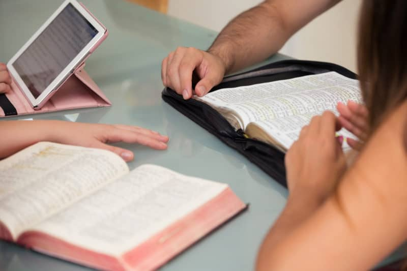 Family studying the Bible together to cultivate a gospel-orientated family culture