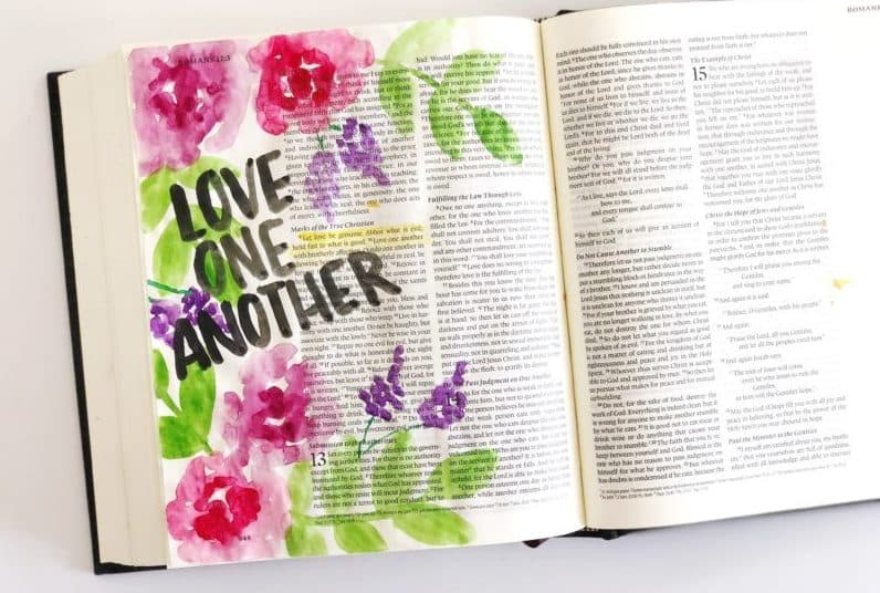 Bible pages that have been creatively painted - Bible Journaling