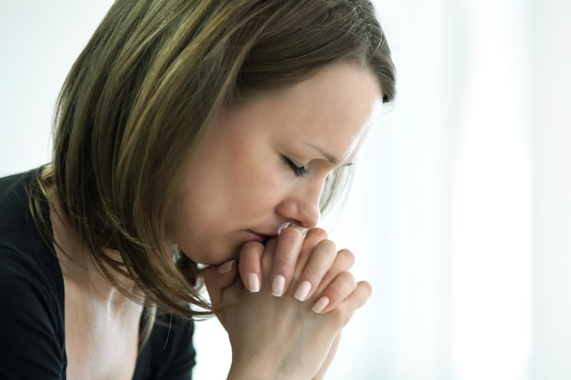woman hands cupped in prayer