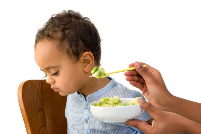 toddler boy refusing to eat his broccoli | article about How to Model Christ-like Humility to Our Children