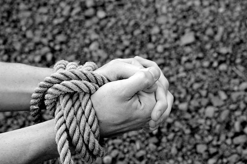 hands clasped together and tied with rope | An Overview of Paul's Epistle to Philemon