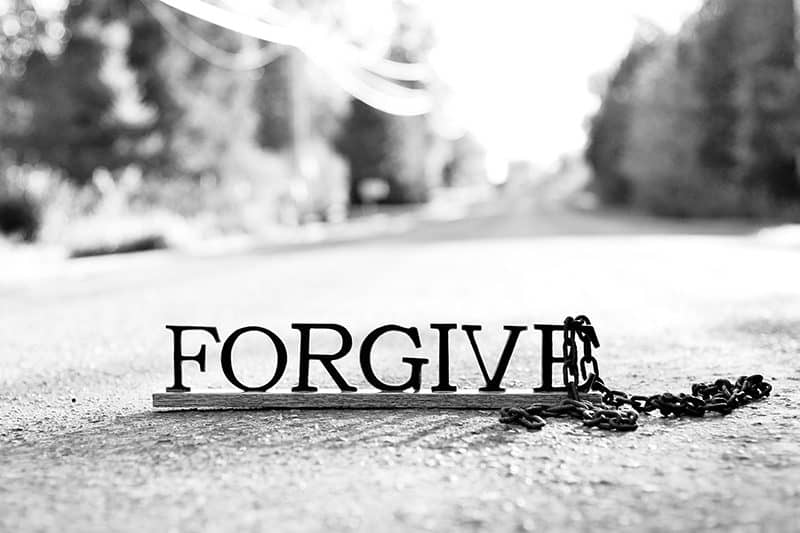 """lettered signed reading """"FORGIVE"""" 
