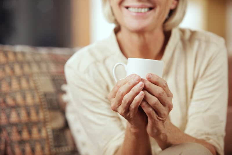 woman enjoying a cup of coffee | article titled: The Adjacent Possible: Applying Spiritual Disciplines to Your Life