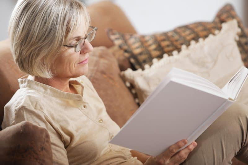 woman on couch reading a book | article titled: The Adjacent Possible: Applying Spiritual Disciplines to Your Life