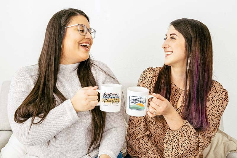 two christian women enjoying fellowship and coffee with their exclusive mugs | pay it foward
