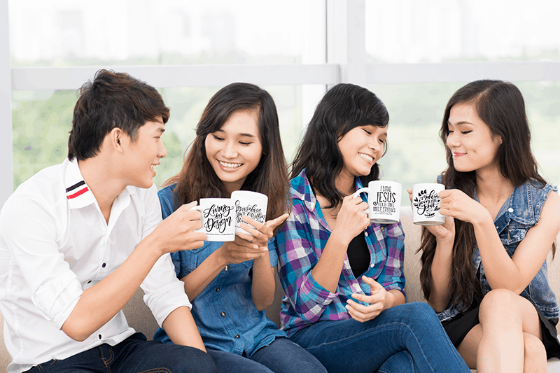 group of friends showing off their mugs while talking | Pay it Forward with our Mug on a Mission Fundraiser - Living by Design Ministries