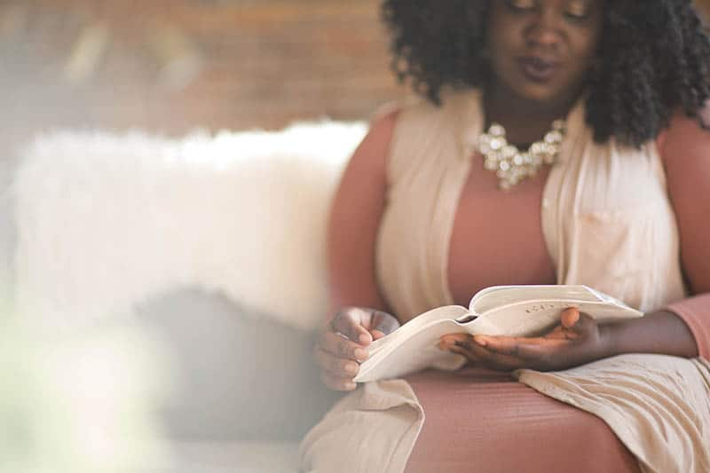 Christian woman studying her Bible | Double your impact this giving season