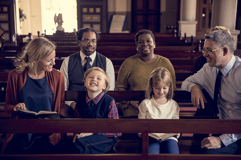 Christian families enjoying time together in church | When Modesty Proclaims the Gospel