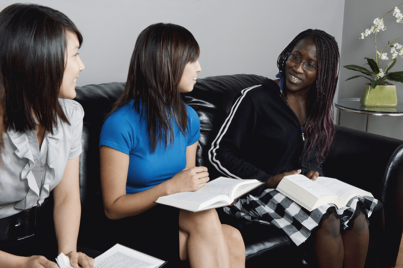 Group of Young Women Studying their Bibles together in a living room | Three Reasons the Old Testament is Still Relevant