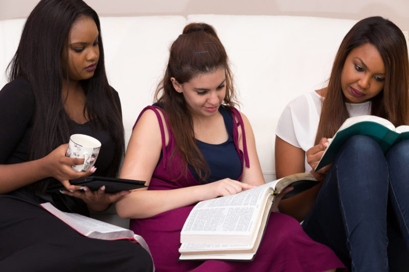 group of women studying the bible together | What is theology & Why does it matter?