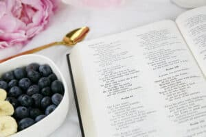 An Open Bible with breakfast food and flowers | Free DWELL360 Study by Living by Design Ministries.
