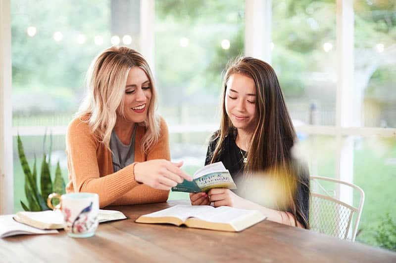 Christian woman mentoring younger woman through Bible study | What do you believe about the Bible?