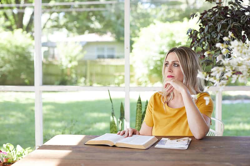 Christian woman pondering the truth of Scripture | What do you believe about the Bible?