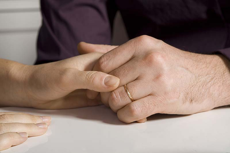 hands of a married couple | when all you can do is pray
