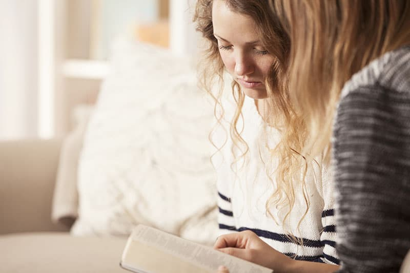 Christian woman learning about the Bible and the beauty of having a prayer partner