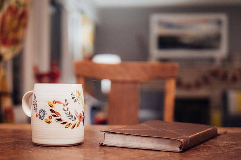 Bible and a cup of coffee on the kitchen table | The Pentateuch & The Pandemic