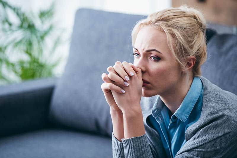 Christian woman pondering the difference between salvation and sanctification