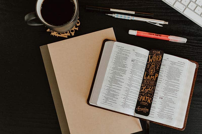 Bible, notebook, coffee, and pens