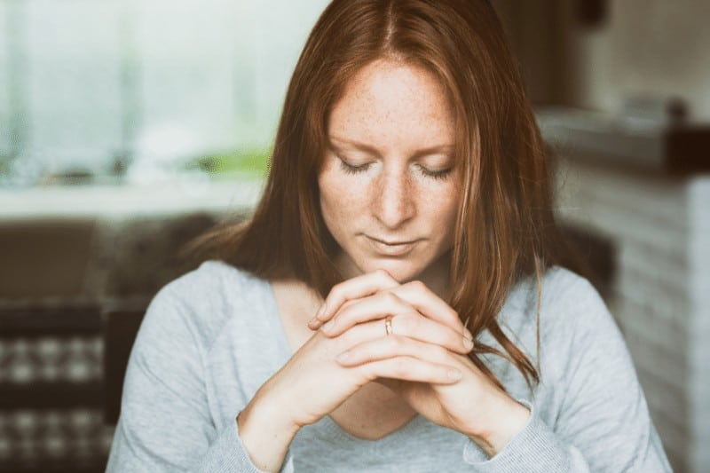 Christian woman praying  | 5 ways to battle Christian complacency