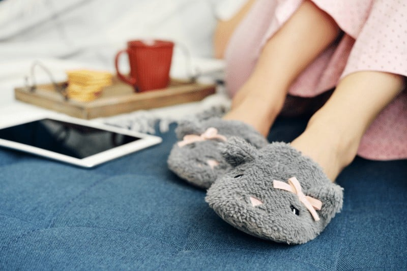 woman in slippers resting on bed   5 ways to battle Christian complacency