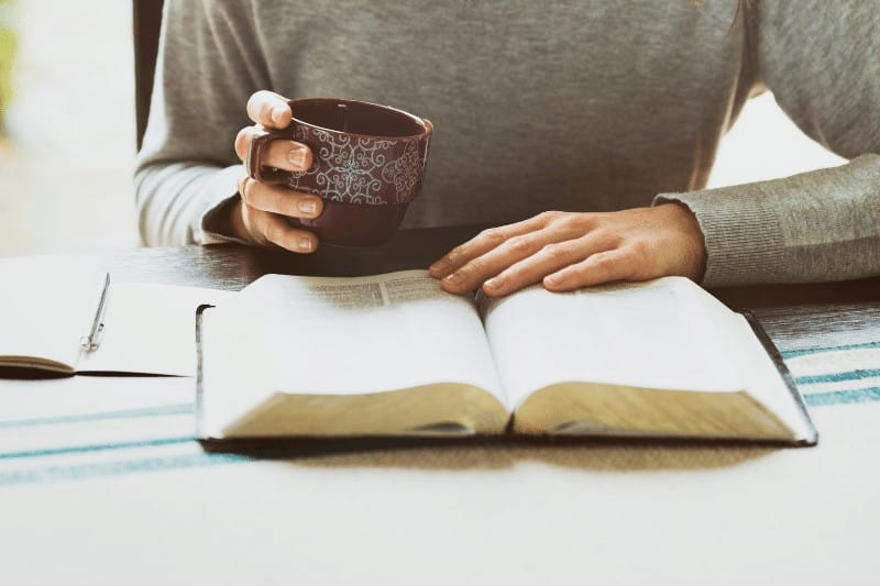 Christian woman spending time with God  | 5 ways to battle Christian complacency