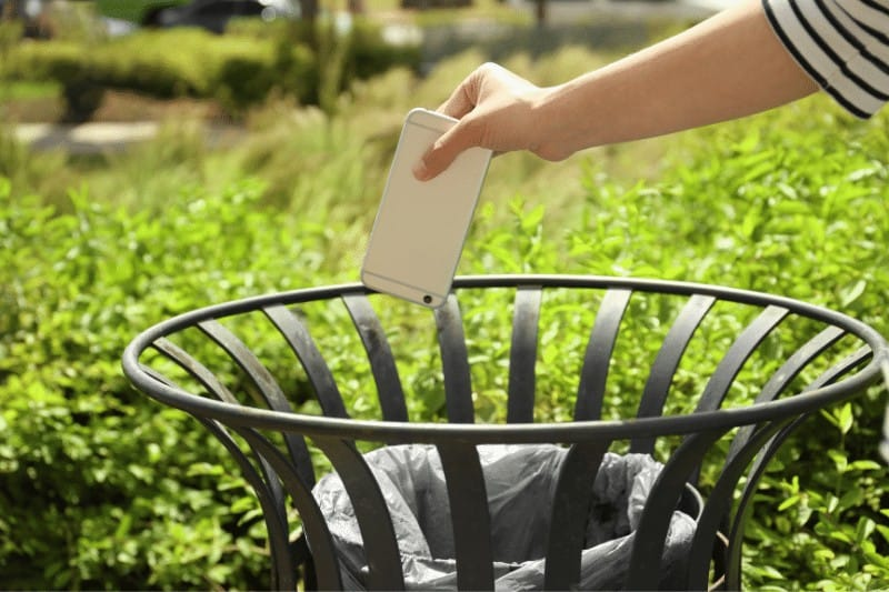 woman throwing away phone  | modern-day idolatry