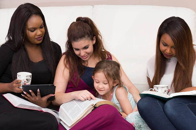 Christian woman bible study group teaching children how to dwell in the word