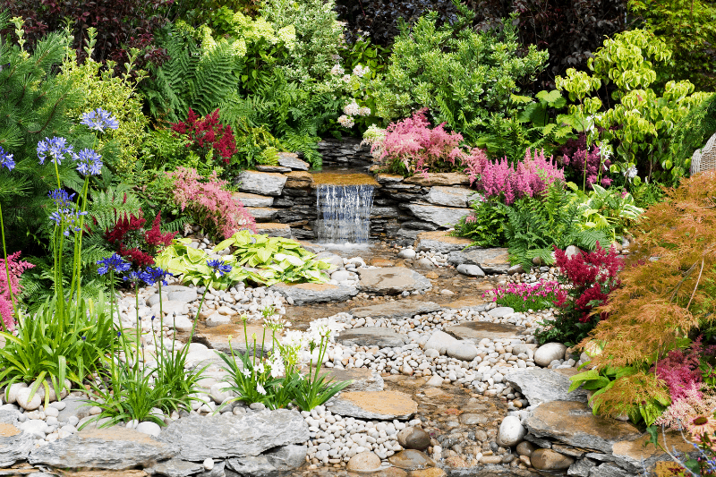 beautiful stream in lush garden | Whose approval are you working for? A Biblical Perspective