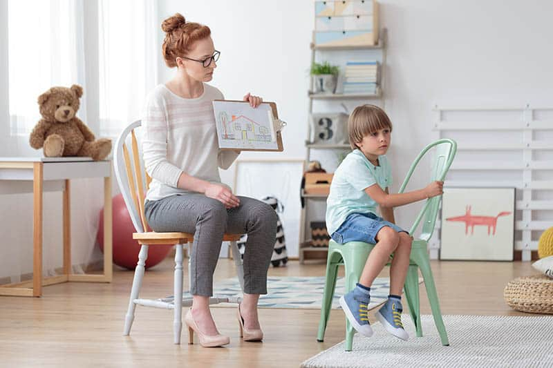 Christian mom trying to teach her son, sad boy sitting on mint chair | Unexpected Change
