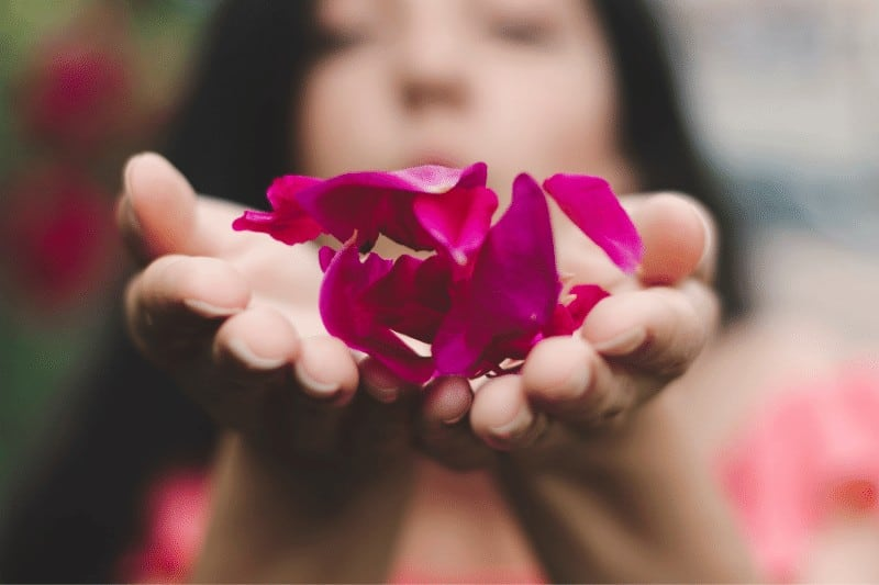 woman holding rose petals | tips for a successful quiet time with God