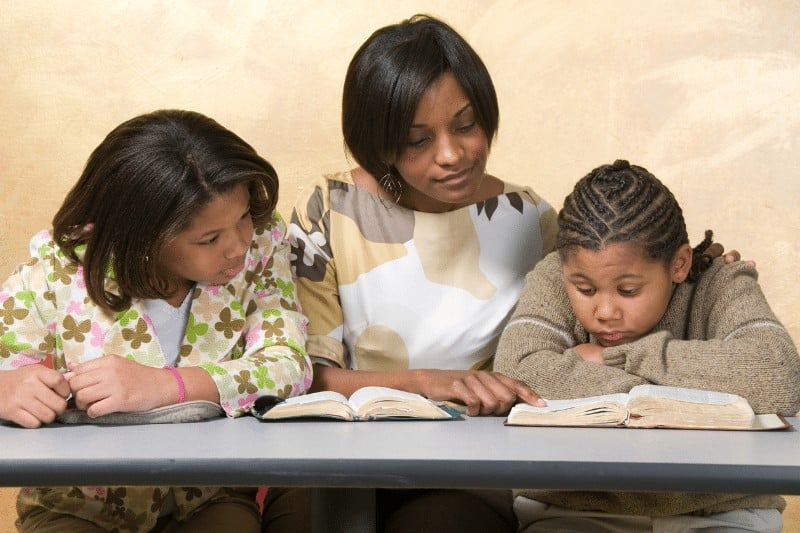 Christian woman teaching her children about the Bible | How to be Intentional Leaders