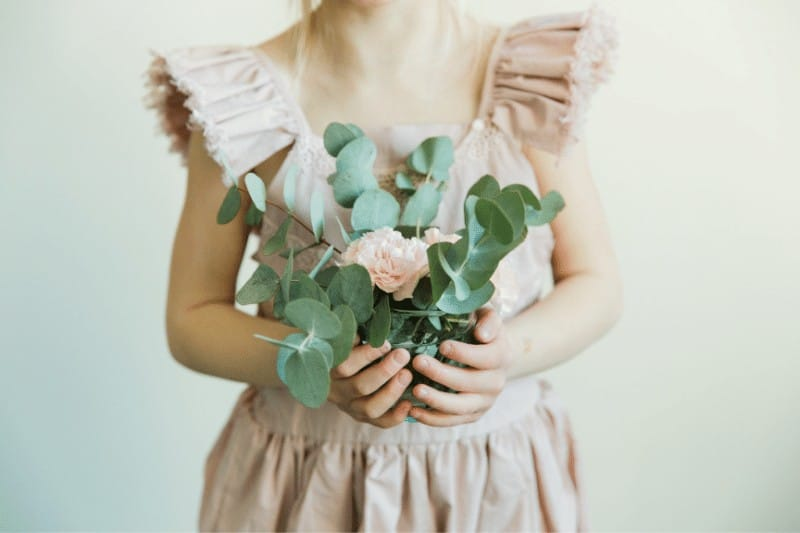 Girl holding flowers   submit to God's Sovereignty