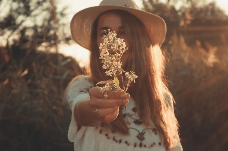 woman holding white flowers    submit to God's Sovereignty