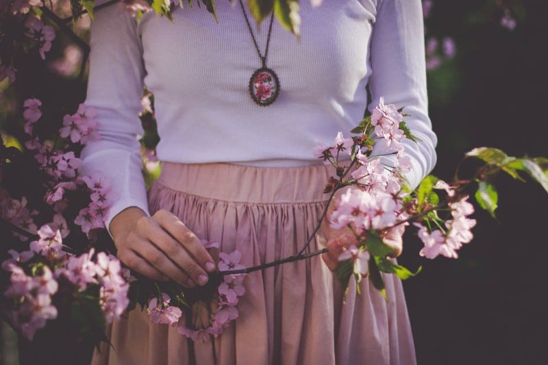 Woman holding cherry blossoms    submit to God's Sovereignty