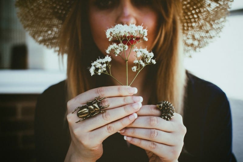 woman holding flowers    submit to God's Sovereignty