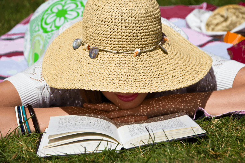 Christian woman working on her free summer Bible study in the sunshine