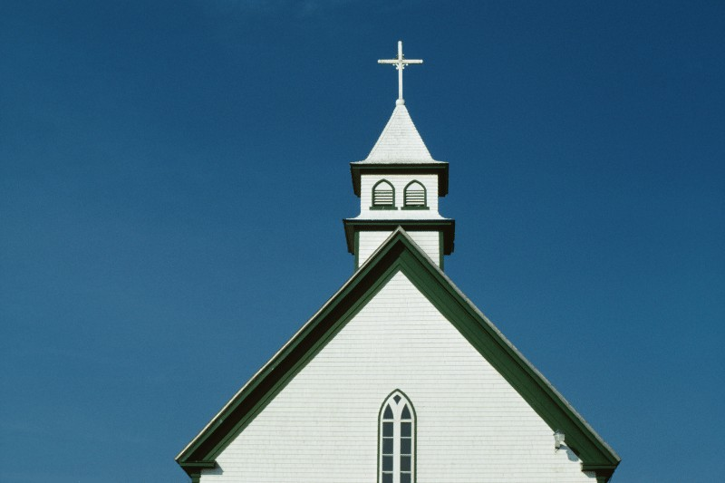 Picture of a white church with a steeple and blue sky background   How to Re-Engage in Church Life Post-Pandemic