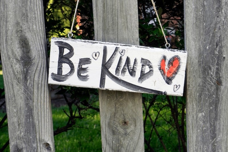 painted sign on a fence that says be kind | 5 Ways to Reflect Christ's Character in Contentious Conversations