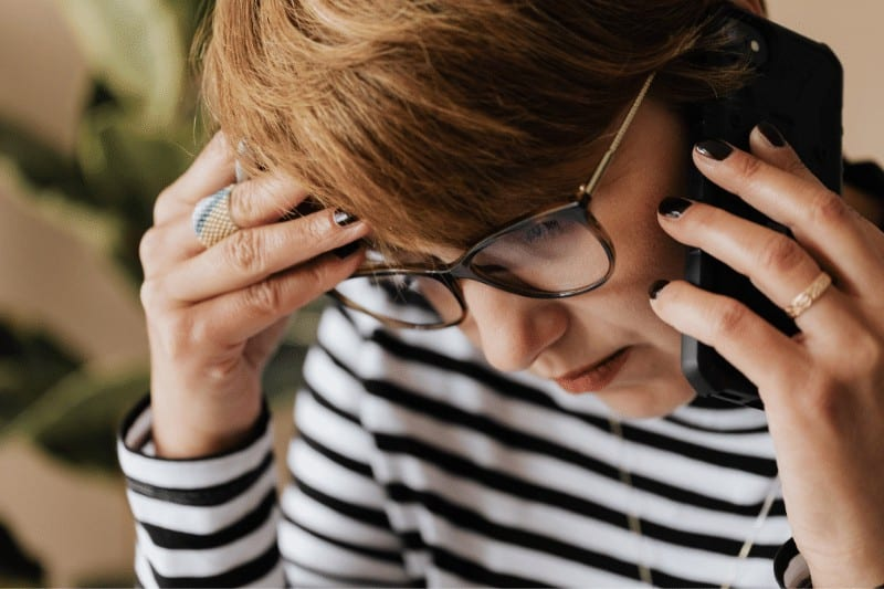 Frustrated woman speaking on the phone to a loved one | 5 Ways to Reflect Christ's Character in Contentious Conversations
