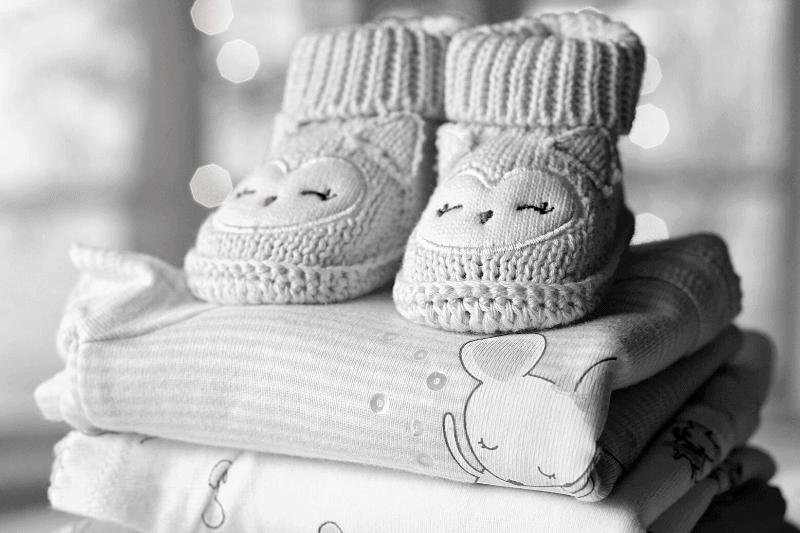 pile of baby blankets with booties on top | A Broken Hallelujah: Practicing Gratitude in Seasons of Grief
