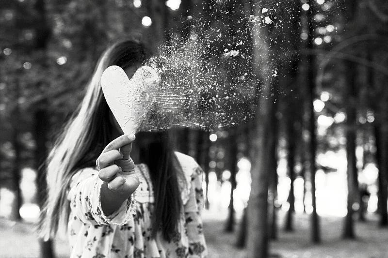 girl holding a paper heart | A Broken Hallelujah: Practicing Gratitude in Seasons of Grief